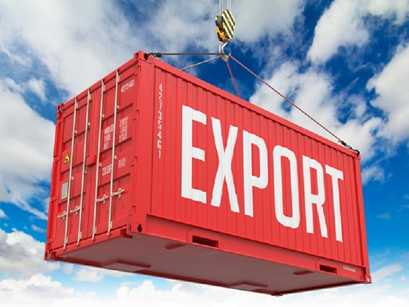 Export - Red Cargo Container hoisted with hook on Blue Sky Background.